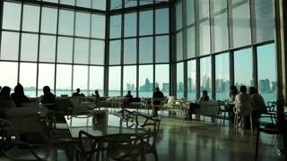 People in cafe inside museum of islamic art in Doha, Qatar