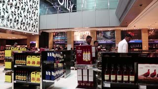 People in duty free store in Hamad international airport in Doha, Qatar
