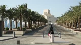 People near museum of islamic art in Doha, Qatar