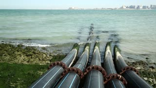 Pipes for intake of sea water and desalination in Doha, Qatar. Desalinization of sea water for city needs, water intake from Persian Gulf, Arabian Peninsula