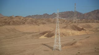 Power transmission towers in desert in Hashemite Kingdom of Jordan. Overhead power line