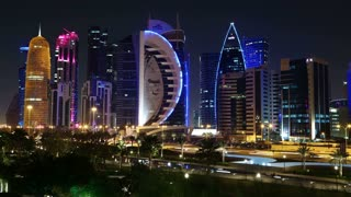 QATAR, DOHA, MARCH 20, 2018: 4K night timelapse of road traffic in financial centre in Doha - capital and most populous city in Qatar, West Bay, Persian Gulf, Arabian Peninsula, Middle East