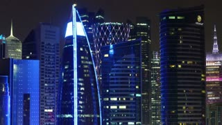 QATAR, DOHA, MARCH 20, 2018: Night cityscape timelapse of financial centre in Doha - capital and most populous city in Qatar, West Bay, Persian Gulf, Arabian Peninsula, Middle East