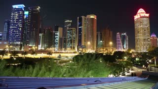 QATAR, DOHA, MARCH 20, 2018: Night tilt timelapse of financial centre in Doha - capital and most populous city in Qatar, West Bay, Persian Gulf, Arabian Peninsula, Middle East