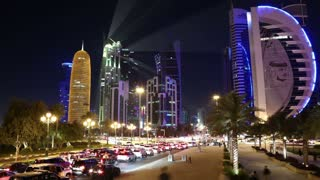 QATAR, DOHA, MARCH 20, 2018: Night timelapse of road traffic in financial centre in Doha - capital and most populous city in Qatar. View on Corniche road in Doha, Persian Gulf, Arabian Peninsula