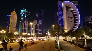 QATAR, DOHA, MARCH 20, 2018: Night timelapse of road traffic in financial district in Doha - capital and most populous city in Qatar. View on Corniche road in Doha, Persian Gulf, Arabian Peninsula