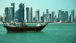 QATAR, DOHA, MARCH 20, 2018: Old wooden dhow and financial centre in Doha - capital and most populous city in Qatar, West Bay, Persian Gulf, Arabian Peninsula, Middle East