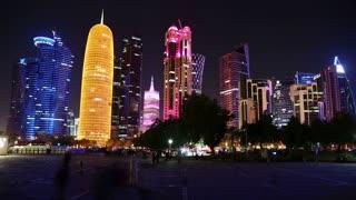 QATAR, DOHA, MARCH 20, 2018: People in public square near skyscrapers in financial centre in Doha - capital and most populous city in Qatar, Corniche road, Persian Gulf, Arabian Peninsula, Middle East