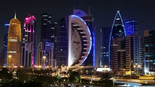 QATAR, DOHA, MARCH 20, 2018: UHD 4K night time lapse of Corniche road traffic in financial centre in Doha - capital and most populous city in Qatar, Persian Gulf, Arabian Peninsula, Middle East