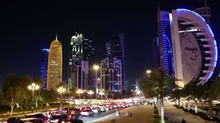 QATAR, DOHA, MARCH 20, 2018: UHD 4K night timelapse of road traffic at financial centre in Doha - capital and most populous city in Qatar, West Bay, Persian Gulf, Arabian Peninsula, Middle East