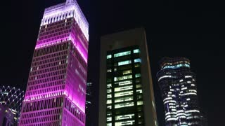 QATAR, DOHA, MARCH 20, 2018: UHD night time lapse of illuminated buildings in financial centre in Doha - capital and most populous city in Qatar, West Bay, Persian Gulf, Arabian Peninsula, Middle East