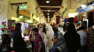 QATAR, DOHA, MARCH 22, 2018: Crowd of people at Souq Waqif or the standing market - eastern bazaar in Doha - capital and most populous city in Qatar, Persian Gulf, Arabian Peninsula, Middle East