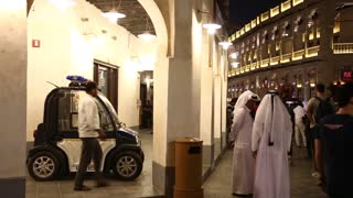 QATAR, DOHA, MARCH 22, 2018: People and police car near police station at Souq Waqif - eastern market in Doha - capital and most populous city in Qatar, Persian Gulf, Arabian Peninsula