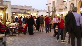 QATAR, DOHA, MARCH 22, 2018: People at Souq Waqif or the standing market - eastern bazaar in Doha - capital and most populous city in Qatar, Persian Gulf, Arabian Peninsula, Middle East