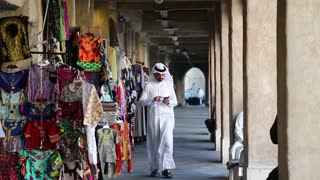 QATAR, DOHA, MARCH 22, 2018: People at Souq Waqif or the standing market - eastern bazaar in Doha - capital and most populous city in Qatar, Persian Gulf, Arabian Peninsula