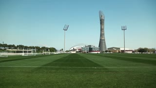 QATAR, DOHA, MARCH 26, 2018: The Torch Doha or Torch tower, also known as Aspire Tower, football fields and Khalifa international stadium in Doha Sports City, also known as Aspire Zone