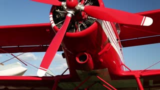 Red old propeller-driven aircraft