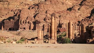 Temenos Gate and Royal Tombs in Petra - ancient historical and archaeological rock-cut city in Hashemite Kingdom of Jordan. Royal Tombs carved in the mountain on background. UNESCO world heritage site