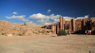 Temenos Gate and Royal Tombs in Petra - ancient historical and archaeological rock-cut city in Hashemite Kingdom of Jordan. Royal Tombs carved in the mountain on background