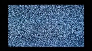 TV channel noise and black hands in television screen