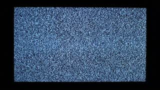 TV channel noise and black silhouette of hands in television screen. Hands strikes in television screen