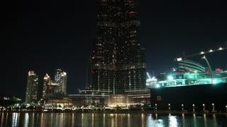 UAE, DUBAI, FEBRUARY 3, 2016: Burj Khalifa megatall skyscraper with night illumination. Burj Khalifa - currently tallest structure and highest skyscraper in the world, Dubai, United Arab Emirates