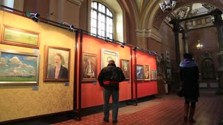 UKRAINE, IVANO-FRANKIVSK, FEBRUARY 23, 2017: People in art museum inside church of the Blessed Virgin Mary in Ivano-Frankivsk city, western Ukraine