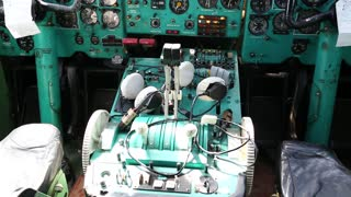 UKRAINE, KIEV, AUGUST 10, 2016: Old aircraft cabin. Inside educational training aircraft Tu-134UBL Combat Trainer. Aircraft instruments panel, interior of old airplane since the Soviet Union