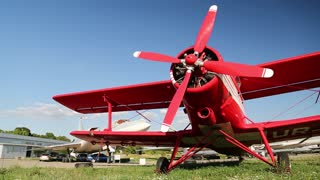 UKRAINE, KIEV, AUGUST 23, 2016: Red small propeller-driven aircraft Antonov An-2 in Kiev aviation museum. Is a Soviet mass-produced single-engine biplane. Agricultural and utility aircraft