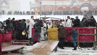 UKRAINE, KIEV, JANUARY 19, 2018: Priests by bank of Dnieper River. Epiphany or Theophany - Christian feast day that celebrates revelation of God incarnate as Jesus Christ, known since 988 AD