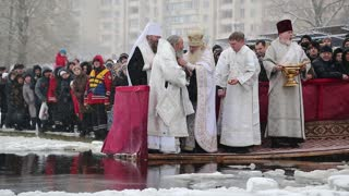 UKRAINE, KIEV, JANUARY 19, 2018: Priests consecrates water of Dnieper River. Epiphany or Theophany - Christian feast day that celebrates revelation of God incarnate as Jesus Christ, known since 988 AD