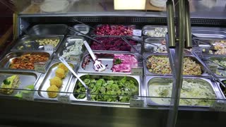 UKRAINE, KIEV, MARCH 5, 2017: Grocery store counter with salads and natural products. Healthy food in grocery store