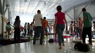 UKRAINE, KIEV, MAY 5, 2016: Active people makes dancing moves in group classes in gym. Men and women goes in for sports. People doing sport, trains in gym. Physical activity helps burn up calories