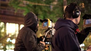 UKRAINE, KYIV, MAY 1, 2017: Video operators with camcorders on tripods records video. Two camera operators works at musical concert