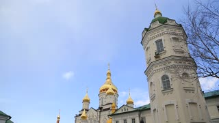 UKRAINE, POCHAYIV, MARCH 25, 2017: People in Holy Dormition Pochayiv Lavra - largest orthodox church complex and monastery in western Ukraine and second in Ukraine, after Kiev-Pechersk Lavra