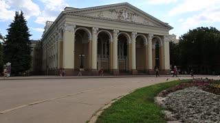 UKRAINE, POLTAVA, JUNE 19, 2017: People near Poltava academic regional Ukrainian music and drama theater named after M.V. Gogol. Poltava - city located on Vorskla River in central Ukraine
