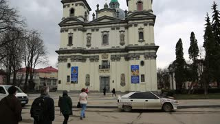 UKRAINE, TERNOPIL, MARCH 24, 2017: People near Dominican church, cathedral of Immaculate conception of Holy Mother of God in Ternopil, city in western Ukraine,historical regions of Galicia and Podolia