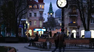 UKRAINE, TERNOPIL, MARCH 24, 2017: People on evening street in Ternopil old town. Ternopil - city in western Ukraine, located on the banks of Seret river, historical regions of Galicia and Podolia