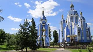 UKRAINE, VINNYTSIA, MAY 27, 2017: People near Greek Catholic Church of the Protection of Holy Virgin near the Southern Bug river in Vinnytsia city, Ukraine