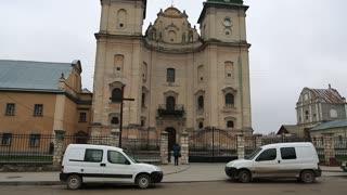 UKRAINE, ZBARAZH, MARCH 25, 2017: Road traffic near Saviour Church, 1600, and that is Bernardine Monastery, 1627, Zbarazh city, Ternopil oblast, located in historic region of Galicia, western Ukraine