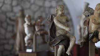 UKRAINE, ZBARAZH, MARCH 25, 2017: Wooden sculptures of Angel, 18th century, unknown author, wood, gesso, polychromia. Zbarazh Castle, located in historic region of Galicia in western Ukraine