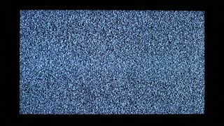 Video noise and black hands on television display. Two hands touch television screen