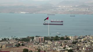 View of Aqaba city in Jordan and Eilat city in Israel. View from mountain in Aqaba city in Jordan. Two city and two country in one video clip