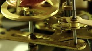 Working internal alarm clock mechanism. Clock mechanism macro shot with tilt
