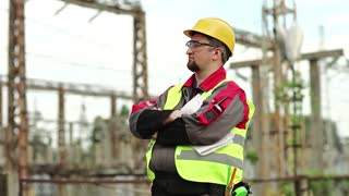 Workman on electric power station. Power engineering specialist in goggles and hard hat at heat power plant looks ahead