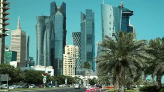 Zoom out timelapse of road traffic at financial centre in Doha, Qatar