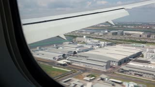 View from the airplane window on the international airport in Bangkok