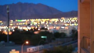 View on evening Aqaba city in Jordan from hotel balcony. City in defocusing