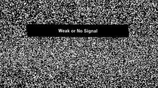 Weak or No Signal inscription on television screen with noise