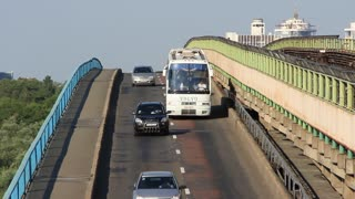 White bus going on the bridge